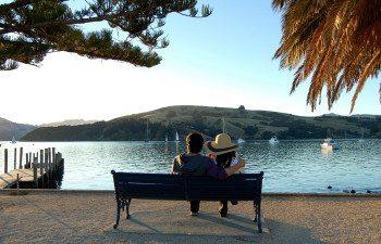 06Akaroa-Couple-on-bench-Raquel-Smith