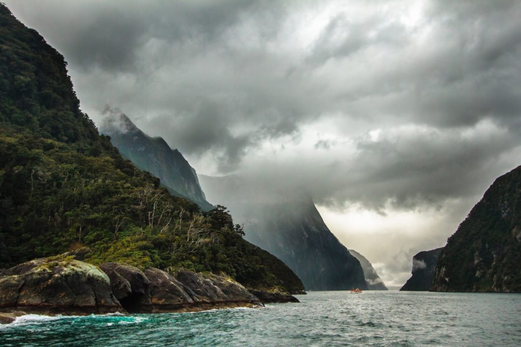 A dark and stormy Milford Sound from the water