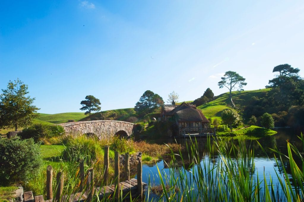 The view over the lake to the Green Dragon Inn, in Hobbiton